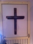 Cross inside (on sale at Art Off Main in Northport approx $45) of screened door frame
