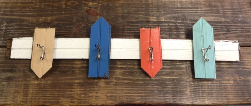 Old painted bead board and antique hooks make this into a creative coatrack. $30